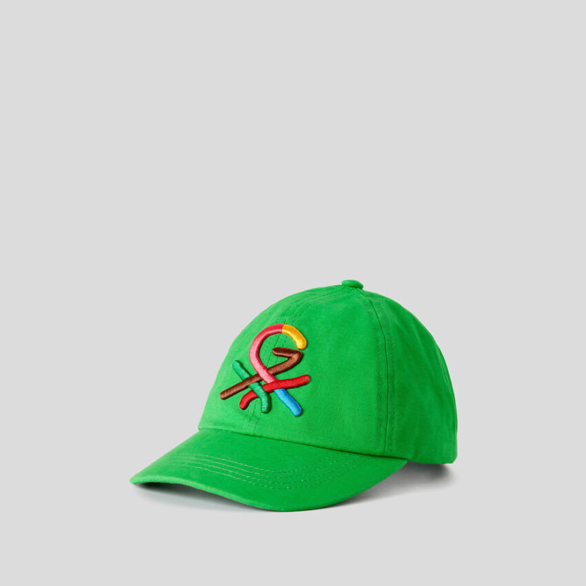 Green hat with embroidered logo by Ghali